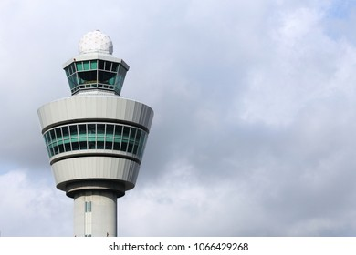 AMSTERDAM, NETHERLANDS - JULY 11, 2017: Air traffic control tower in Schiphol Airport, Amsterdam. Schiphol is the 12th busiest airport in the world with more than 63 million annual passengers.