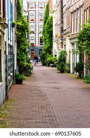 Amsterdam, Netherlands - July 13, 2017:  Narrow city streets for walking pedestrians throughout the city of Amsterdam, Netherlands capital city.