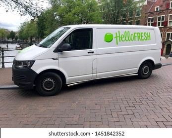Amsterdam, the Netherlands - July 15, 2019: White Volkswagen Transporter HelloFresh delivery van parked by the side of the road. Nobody in the vehicle.