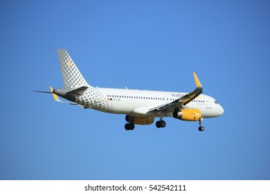 Amsterdam, the Netherlands - July 15th 2016: EC-LZE Vueling Airbus A320, approaching Polderbaan runway at Schiphol Amsterdam Airport, arriving from Barcelona, Spain