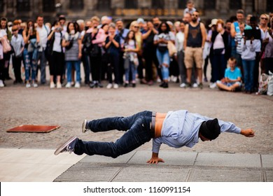 Amsterdam, The Netherlands - July 16 2018: street performer on Dam Square