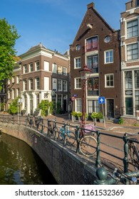 Amsterdam, Netherlands - July 20, 2018:  Buildings along Amsterdam's beautiful Prinsengracht canal in the Jordaan District during the day. Jordaan is one of Amsterdam's most poplar neighbourhoods