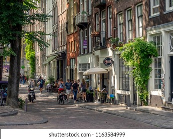 Amsterdam, Netherlands - July 20, 2018: Street and buildings on a beautiful street in the Jordaan district of Amsterdam.