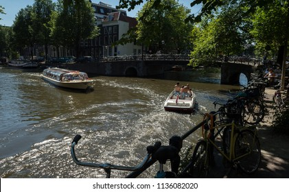 Amsterdam, Netherlands, July 2018: Boats in the summer sun on the Brouwersgracht canal, Amsterdam, Netherlands