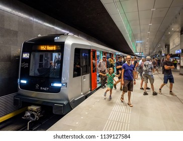 Amsterdam, Netherlands, July 2018. Passengers getting out of the train at station Rokin on the first day of the new Noord/Zuidlijn subway