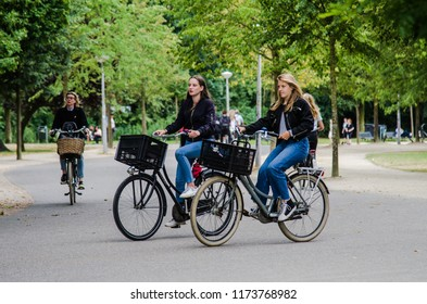 AMSTERDAM, NETHERLANDS; JULY 2018 People riding bicycles in Vondelpark in summer feeling chill and relax at Amsterdam, Netherland.