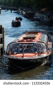 Amsterdam, Netherlands, July 2018: Summer cruising on Amsterdam's canals, Netherlands