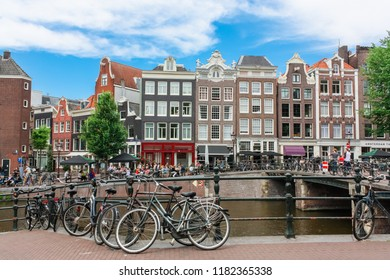 Amsterdam, Netherlands. July, 2018. View of the city, old houses, canals and rivers. City landscape. Tourist place. Sights.