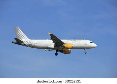 Amsterdam, the Netherlands - July 21st 2016: EC-KHN Vueling Airbus A320, approaching Polderbaan runway at Schiphol Amsterdam Airport, arriving from Porto, Rome