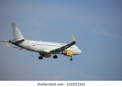 Amsterdam, the Netherlands - July 21st 2016:EC-LVX  Vueling  Airbus A320, approaching Polderbaan runway at Schiphol Amsterdam Airport, arriving from Santiago