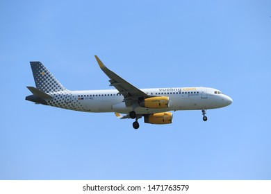 Amsterdam, the Netherlands - July 21st 2019: EC-MEL Vueling Airbus A320-200 on final approach to Amsterdam Airport Schiphol Polderbaan runway