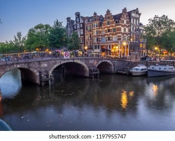 Amsterdam, Netherlands - July 22, 2018: Buildings and house boats along the Brouwersgracht, a canal in the heart of the Netherlands beautiful capital city of Amsterdam.