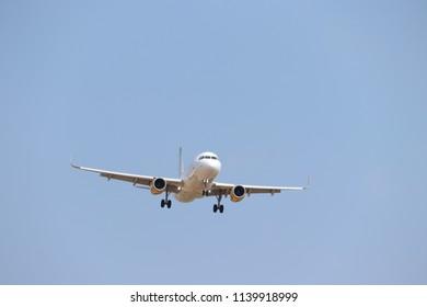 Amsterdam the Netherlands - July 22nd 2018: EC-MFN Vueling Airbus A320-200 final approach to Schiphol Zwanenburgbaan runway, Amsterdam Airport Schiphol