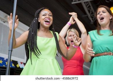 Amsterdam, the Netherlands - July 23, 2016: ZO gospel choir performing at the open air theater in Vondelpark for the Euro Pride Pink Saturday celebrations