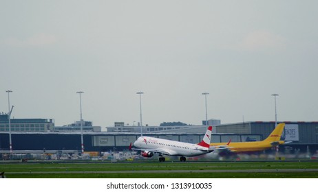 AMSTERDAM, NETHERLANDS - JULY 25, 2017: Side view of Embraer-195LR OE-LWL of Austrian airlines accelerates on runway at Schiphol airport