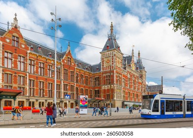 Amsterdam, Netherlands - July 29, 2014: The tram stop near Centraal station. Amsterdam Centraal station is the largest train station of Amsterdam and a major national rail hub with 260,000 passengers