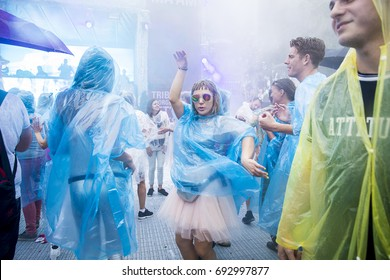 Amsterdam, The Netherlands - July 29 2017: people dancing under the rain with their rain ponchos on at Milkshake Festival in Westerpark
