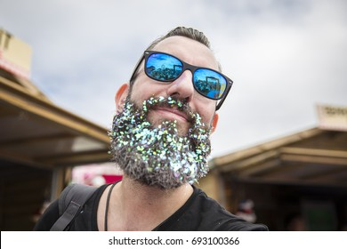 Amsterdam, The Netherlands - July 29 2017: man with a beard full of shiny blue glitters at Milkshake Festival in Westerpark