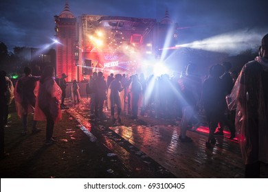 Amsterdam, The Netherlands - July 29 2017: view of the festival at night with poeple partying and dancing under the rain at Milkshake Festival in Westerpark