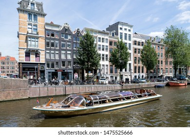 AMSTERDAM, THE NETHERLANDS - JULY 4, 2019: Amsterdam canal boat PRINSES BEATRIX of Rederij Kooij on the Herengracht.