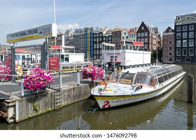 AMSTERDAM, THE NETHERLANDS - JULY 4, 2019: Amsterdam canal boat LUDWIG VAN BEETHOVEN of Stromma Netherlands at pier nearby the central station.