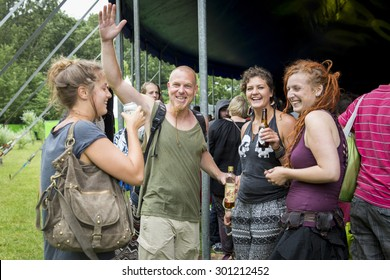 Amsterdam, The Netherlands - July, 5 2015: group of friends during Amsterdam Roots Open Air, a cultural festival held in Park Frankendael on 05/07/2015