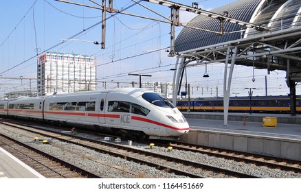 Amsterdam / Netherlands - July 6 2018: An ICE High Speed Train departs from the central station of Amsterdam as international train to Köln and Frankfurt in Germany.