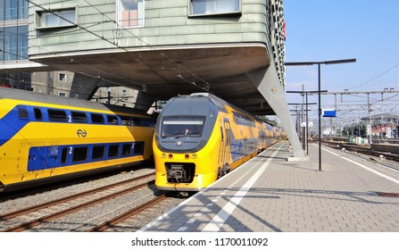 Amsterdam / Netherlands - July 6 2018: Dutch modern NS train (VIRM) arrived at the central station of Amsterdam.