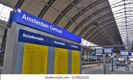 Amsterdam / Netherlands - July 6 2018: Travel information board with the station name of Amsterdam Central Station!