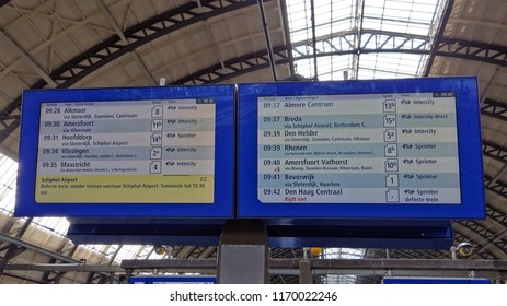 Amsterdam / Netherlands - July 6 2018:  Travel information board with the departure times of the trains at Amsterdam Central Station with some delay signs