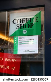 AMSTERDAM, NETHERLANDS - JULY 7, 2017: Legal permit in a window of a coffee shop in Amsterdam, Netherlands. Coffeeshops legally sell marijuana for personal consumption.