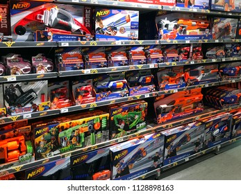 Amsterdam, the Netherlands - July 7, 2018: Assortment of various NERF foam-based weaponry on a toys store shelf.