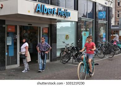 AMSTERDAM, NETHERLANDS - JULY 8, 2017: Customers visit Albert Heijn supermarket in Amsterdam. Sales turnover of supermarkets in Netherlands has grown 32 percent in years 2006-2016.
