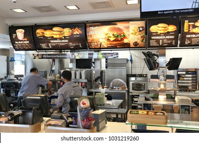 AMSTERDAM, NETHERLANDS - JULY 8, 2017: Employees work the kitchen of McDonald's restaurant in Amsterdam. McDonald's is the world's largest restaurant chain with 69 million customers served daily.