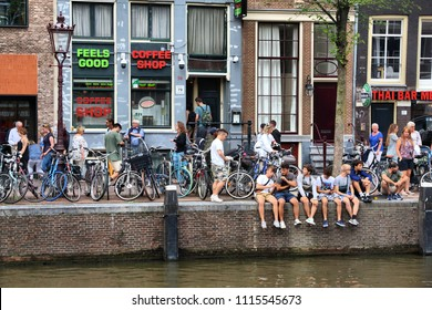 AMSTERDAM, NETHERLANDS - JULY 8, 2017: People visit a coffee shop in Amsterdam, Netherlands. Coffeeshops legally sell marijuana for personal consumption.