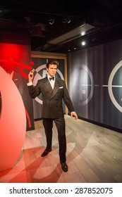 AMSTERDAM, NETHERLANDS - JUN 1, 2015: Pierce Brosnan as the agent 007 James Bond in Madame Tussauds museum in Amsterdam. Marie Tussaud was born as Marie Grosholtz in 1761