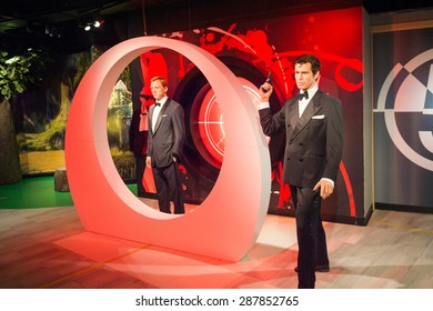 AMSTERDAM, NETHERLANDS - JUN 1, 2015: Daniel Craig and Pierce Brosnan as the agent 007 James Bond in Madame Tussauds museum in Amsterdam. Marie Tussaud was born as Marie Grosholtz in 1761