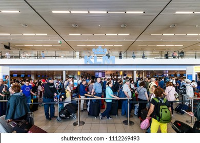 Amsterdam, Netherlands - June 01, 2018: People People At Check In At Schiphol Airport