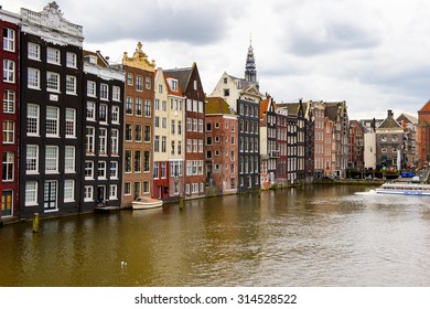 AMSTERDAM, NETHERLANDS - JUNE 1, 2015: Architecture of Damrak street of Amsterdam, Netherlands. Amsterdam is the capital of Netherlands and a popular touristic destination