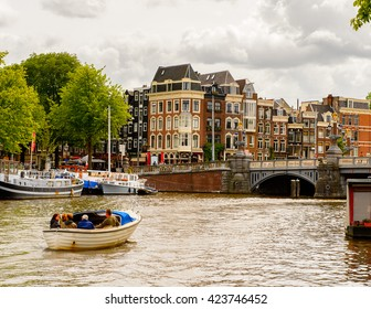 AMSTERDAM, NETHERLANDS - JUNE 1, 2015: Canal of Amsterdam, Netherlands. Amsterdam is the capital of Netherlands and a popular touristic destination