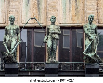 AMSTERDAM, THE NETHERLANDS - JUNE 11, 2016: Plower, sower and mower. Bronze facade sculptures in Leidsestraat, Amsterdam, Holland. Made in 1935 by sculptor Theo van Delft.