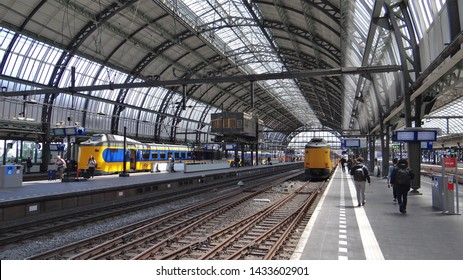 Amsterdam / Netherlands - June 11 2019: Dutch modern NS Intercity trains (ICMm) at the central railway station of Amsterdam (CS)