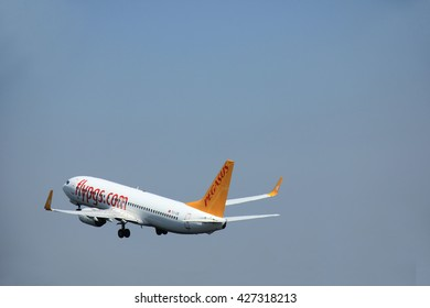 Amsterdam, The Netherlands - June 12 2015: TC-IZE Pegasus Boeing 737-800 takes of from Amsterdam Airport Polderbaan runway. Pegasus Airlines is a low-cost airline headquartered in  Istanbul, Turkey.