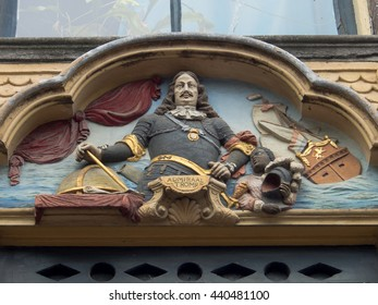 AMSTERDAM, THE NETHERLANDS - JUNE 12, 2016: Facade of a canal house portraying Maarten Harpertszoon Tromp (1598-1653), admiral in the Dutch navy, in Amsterdam, The Netherlands on June 12, 2016