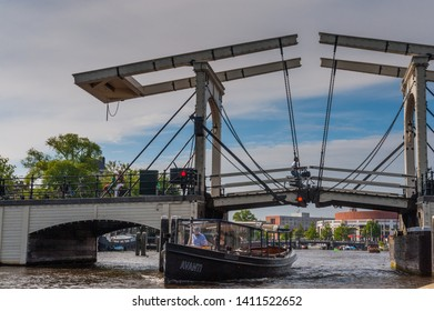 Amsterdam, the Netherlands. June 13, 2014. Impression of the famous magere brug -the skinny brigde- in central amsterdam, as seen from a canal boat.