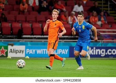 AMSTERDAM, NETHERLANDS - JUNE 13, 2021: Frenkie de Jong (21) vs Ruslan Malinovskyi (8) EURO 2020. The football match Ukraine vs Netherlands