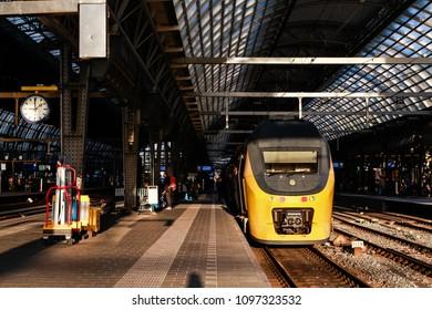 AMSTERDAM, NETHERLANDS - JUNE 15, 2014: NS train in evening sun at Amsterdam central station in Netherlands