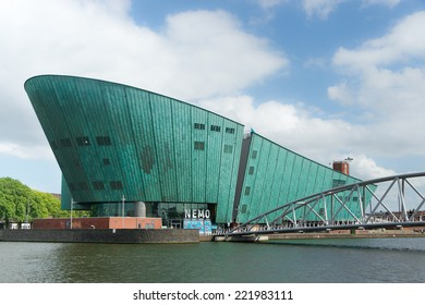 AMSTERDAM, THE NETHERLANDS - June 15, 2014: The Nemo (Science) Museum, designed in the form of a ship by architect Renzo Piano and seen from the water in Amsterdam, The Netherlands, on June 15, 2014.