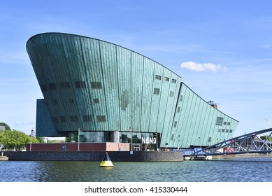 Amsterdam, Netherlands - June 15, 2015: NEMO science center of Amsterdam. Maritime museum near Amsterdam Centraal Station. Futuristic building exterior at a sunny day in summer.