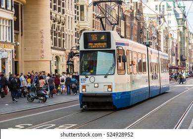 AMSTERDAM, THE NETHERLANDS - JUNE 16, 2016: City tram in Amsterdam in a beautiful summer   day, The Netherlands on June 16, 2016